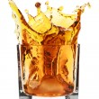 Glass with splashing whisky drink — Stock Photo