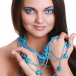 Fashionable woman with blue beads — Stock Photo