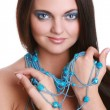 Fashionable woman with blue beads - Stock Photo