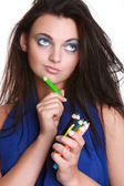 Beautiful girl with a make-up brush — Stock Photo