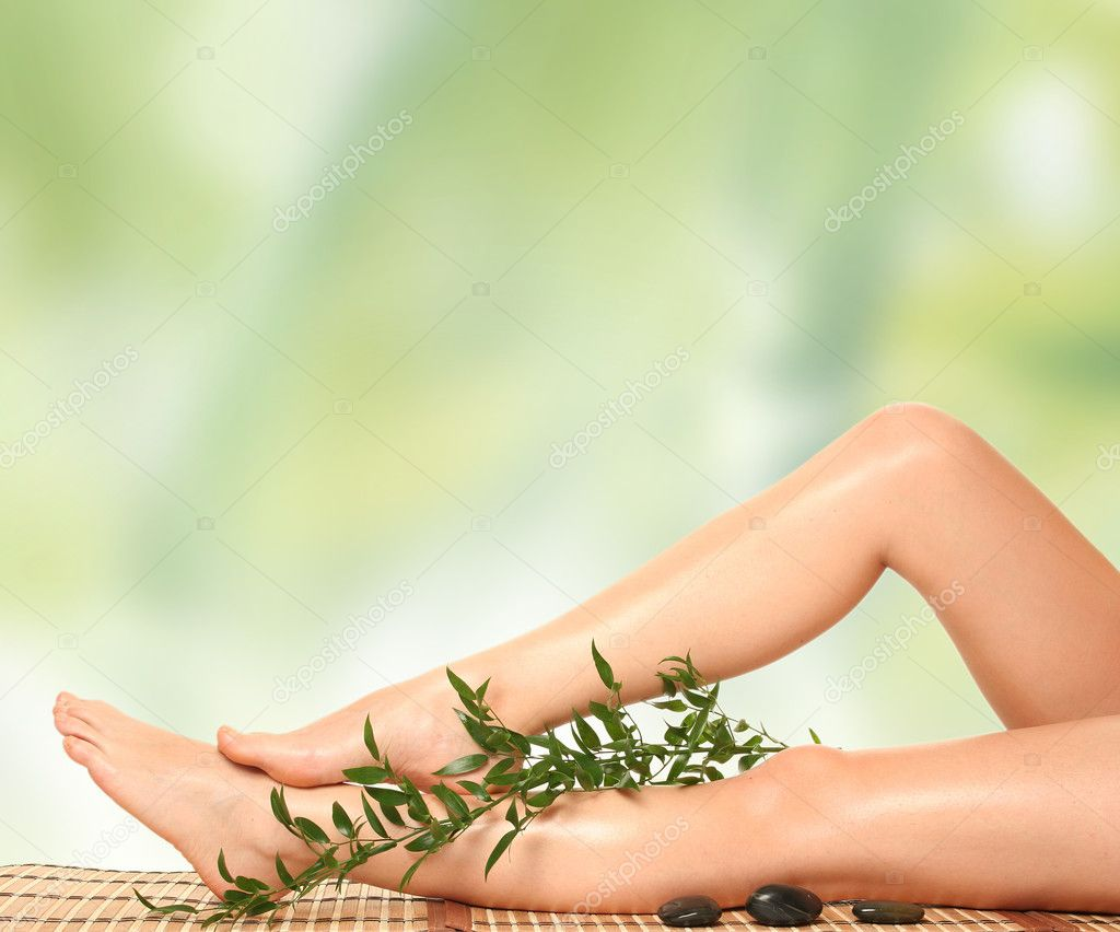 Beautiful slim woman's legs isolated on white — Stock Photo #2778475