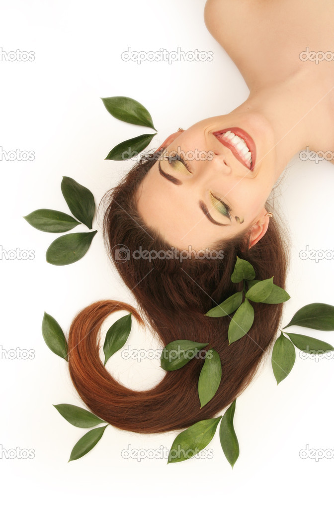 Beautiful young woman with green leaves — Stock Photo #2831353
