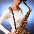 Saxophone on blue — Stock Photo