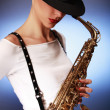 Stock Photo: Saxophone on blue
