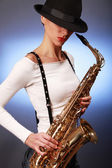 Saxophone on blue — Stock Photo