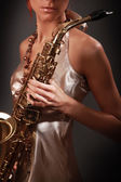 Woman saxophonist — Stock Photo
