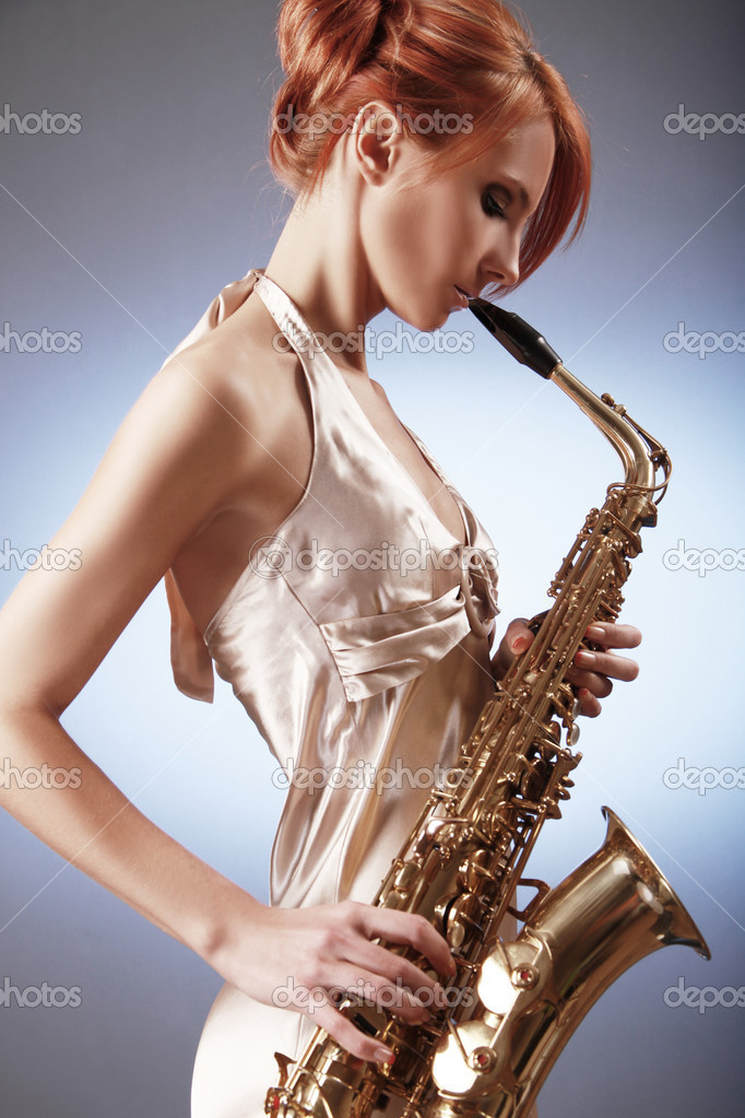 Sexy young woman with saxophone — Stock Photo #2843215