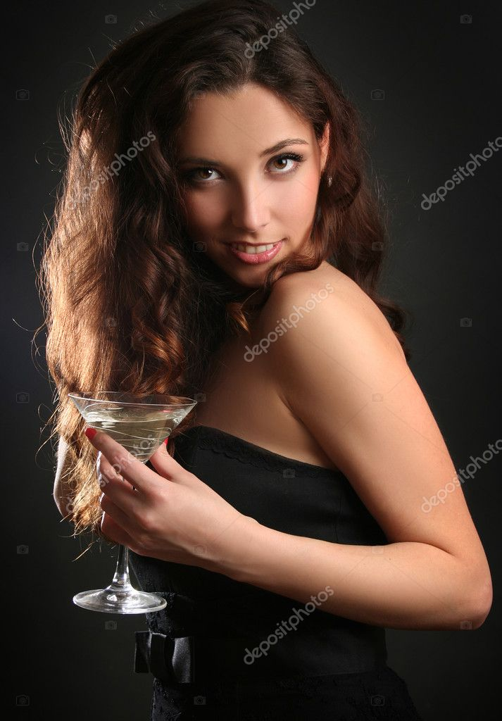 Beautiful young woman drinking cocktail — Stock Photo #2924861