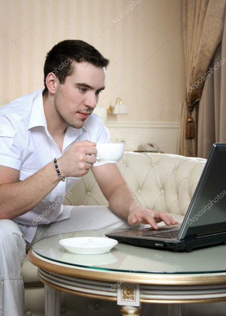 Attractive young man with laptop  Stockfoto #3263865