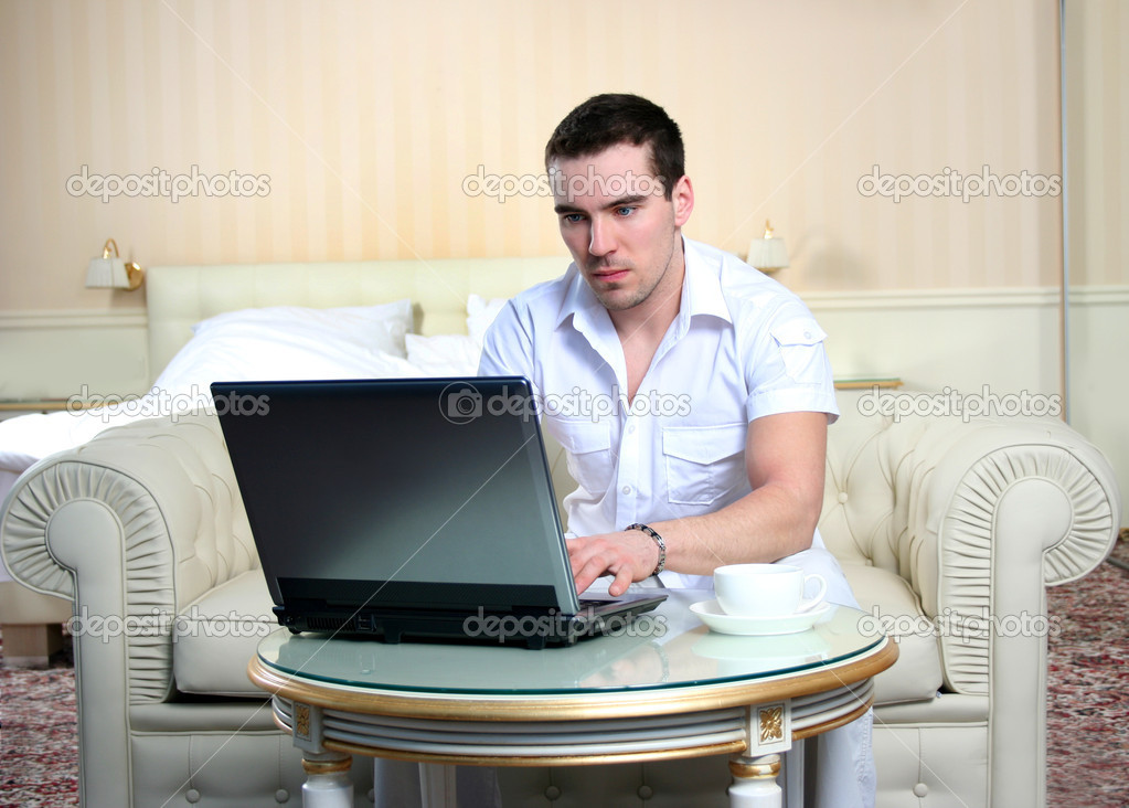Attractive young man with laptop  Stock Photo #3263898