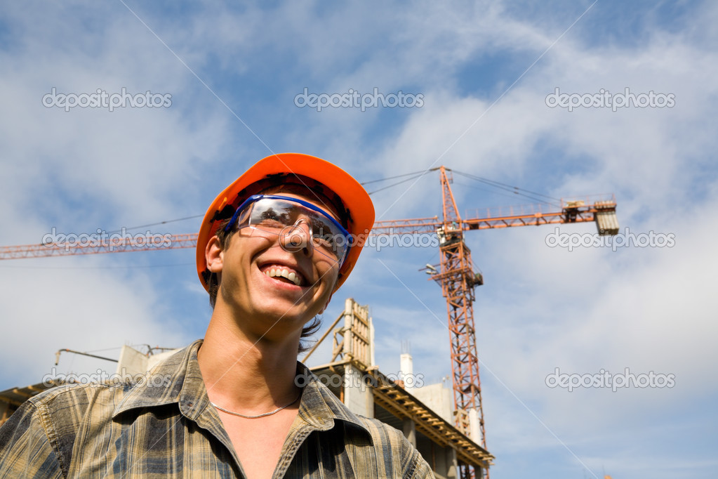 The young builder on a background of a builded building. — Stock Photo #2707456