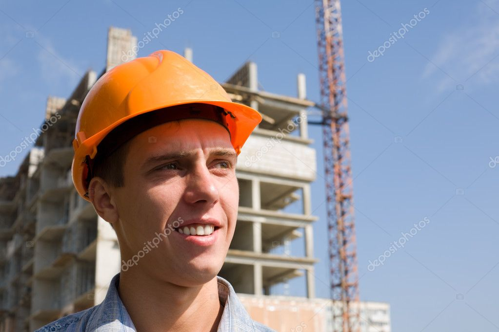 The young builder on a background of a builded building. — Stock Photo #2707593