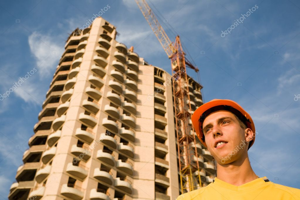 The young builder on a background of a builded building. — Stock Photo #2707595