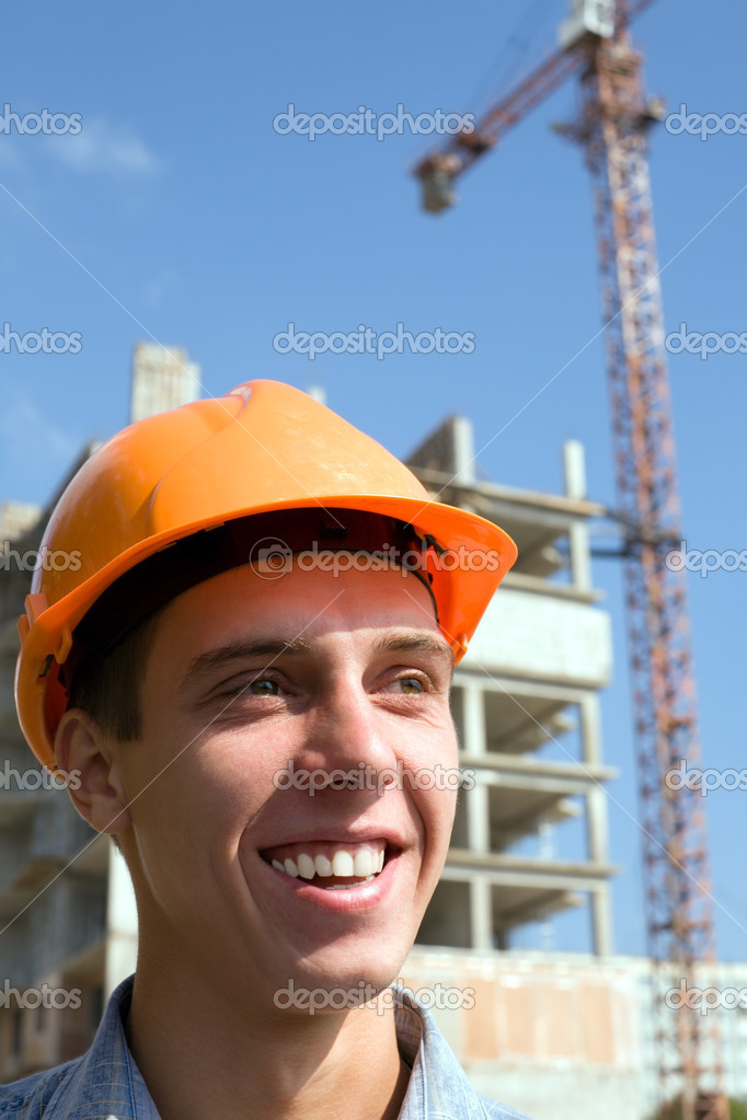 The young builder on a background of a builded building. — Photo #2708614