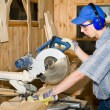 Carpenter & electric saw — Stock Photo