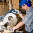 Stock Photo: Carpenter & electric saw