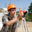 Stock Photo: Builder and level
