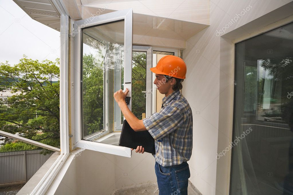 The building inspector checks quality of installation of new windows. — Zdjęcie stockowe #2716646