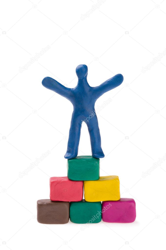 Plasticine mason and brick pyramid-pedestal. — Stock Photo #2823950