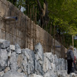 Construction wall of natural stone — Stock Photo