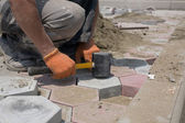 Worker paving stones — Stock Photo
