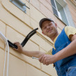 Installer sets a new air conditioner - Stockfoto