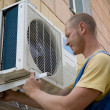Installer sets a new air conditioner — Stock Photo #3387547