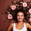 Stock Photo: Woman and gerbera