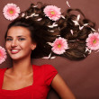 Woman and gerbera - Stock Photo