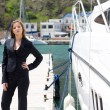 Woman and boat - Stock Photo