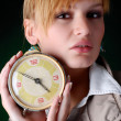 Woman with alarm clock — Stock Photo #2904286