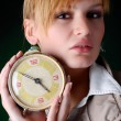 Stock Photo: Womwith alarm clock
