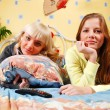 Stock Photo: Two women at the bedroom