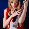 Woman with electric guitar — Stock Photo