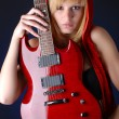 Woman with electric guitar — Stock Photo #2904410