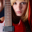 Woman and red guitar — Stock Photo