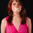 Woman with cross on her mouth — Stock Photo #2904472
