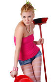 Woman with dustpan and broom — Stock Photo