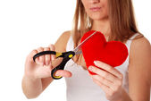 Woman with scissors and red heart — Stock Photo