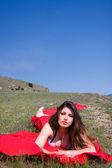 Beautiful woman in red — Stock Photo