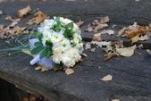 Wedding bouquet on bench — Stock Photo