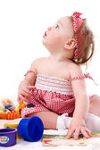 Little beautiful girl with toys — Stock Photo