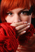 Woman with red clew — Stock Photo