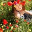 Woman and circlet of flowers — Stock Photo