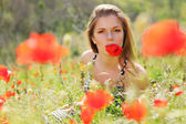 Woman and poppies — Stock Photo