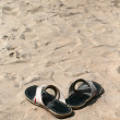 Sandals and sand — Stok fotoğraf