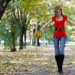 Woman walking in park — Stock Photo