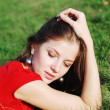 Young woman  and green grass — Stockfoto