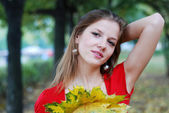 Woman with yellow leaves — Stockfoto