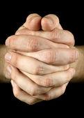 Praying hands on black background — Stock Photo